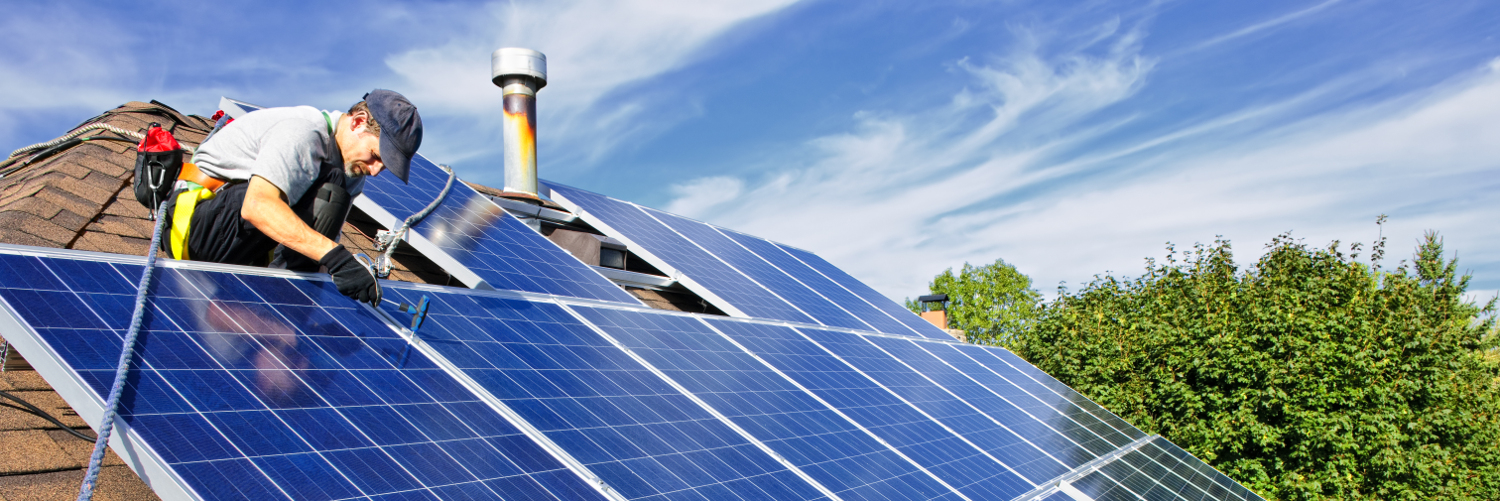 Professional installs solar panels on roof